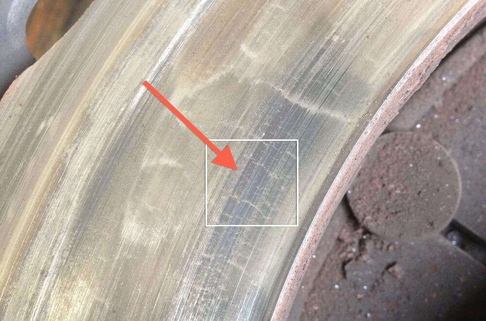 You can see that there are heat cracks in this clutch where the arrow is pointing. These can be machined out as long as they're not too deep.